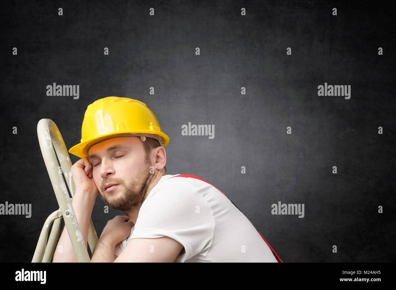 Lazy worker with ladder - Stock Image