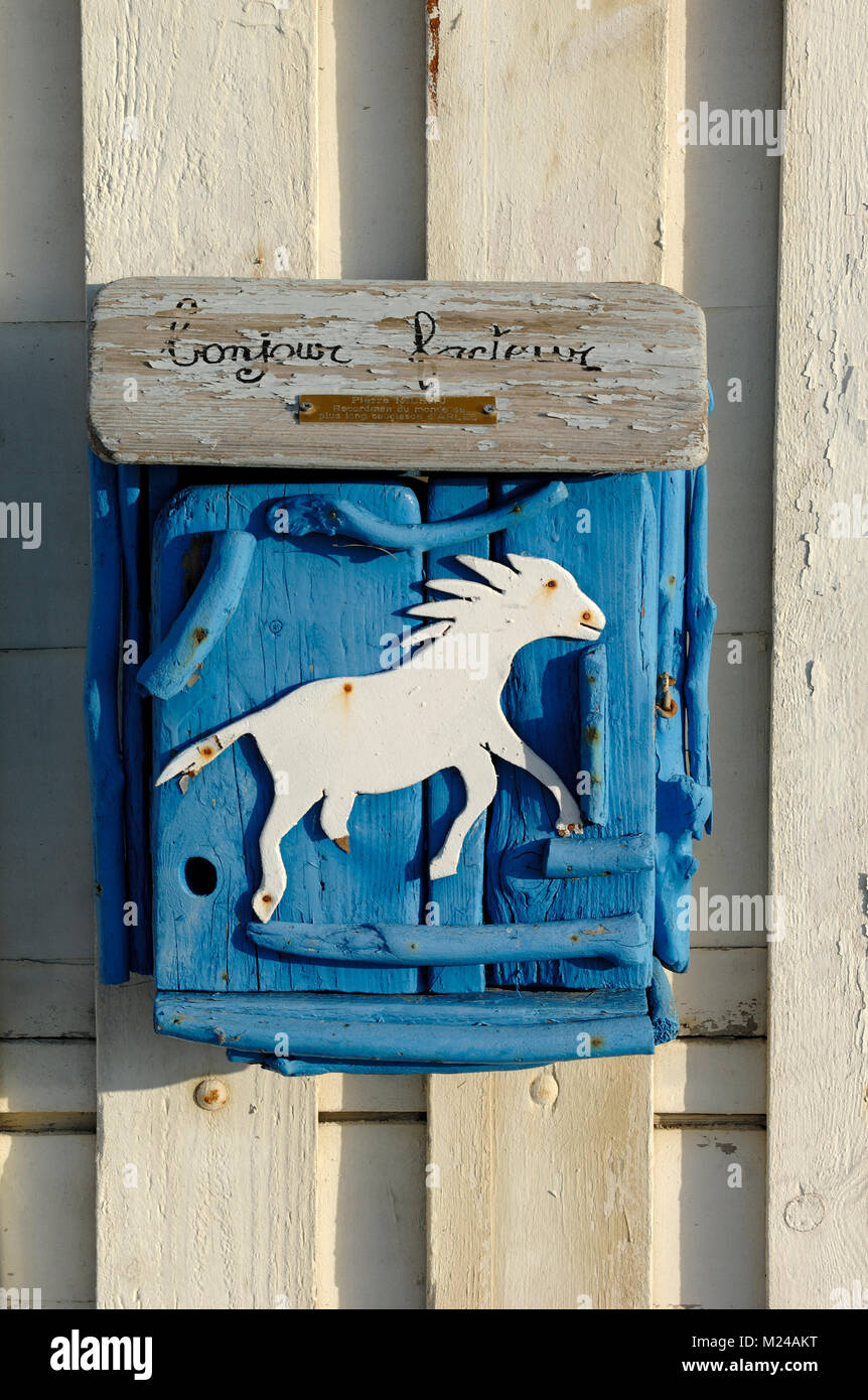 Unusual Handmade Painted Post Box or Mail Box with Carved Wooden White Horse Camargue Provence  France - Stock Image