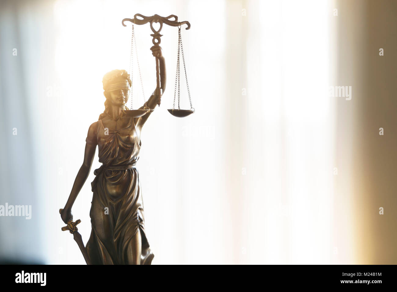 Statue of Justice with scales in lawyer office. Legal law, advice and justice concept - Stock Image
