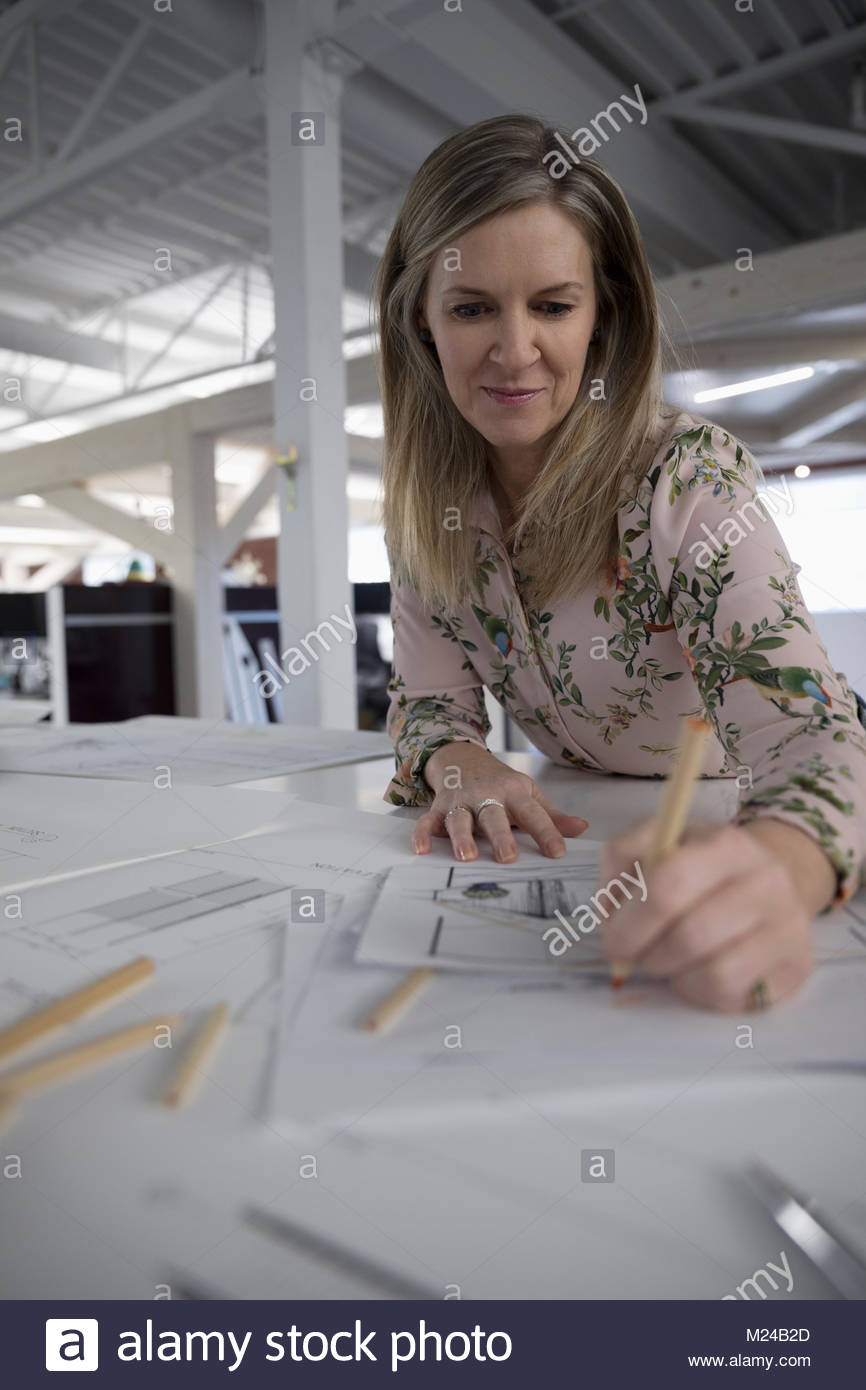 Architect working at table in office - Stock Image
