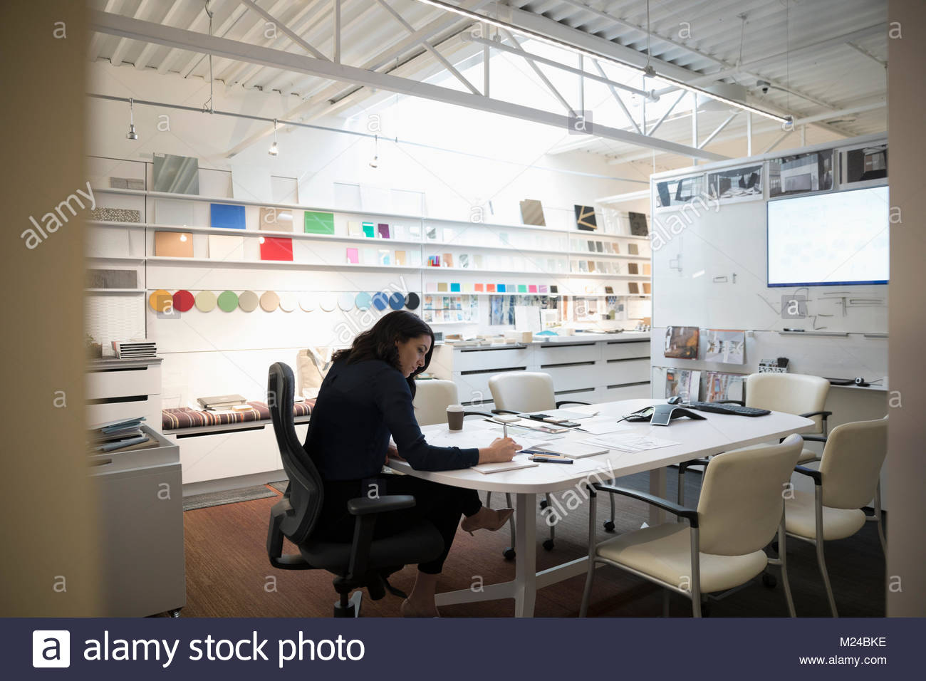 Designer working in creative office - Stock Image