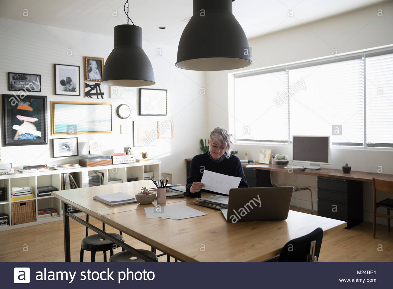Creative businesswoman entrepreneur working in studio office - Stock Image