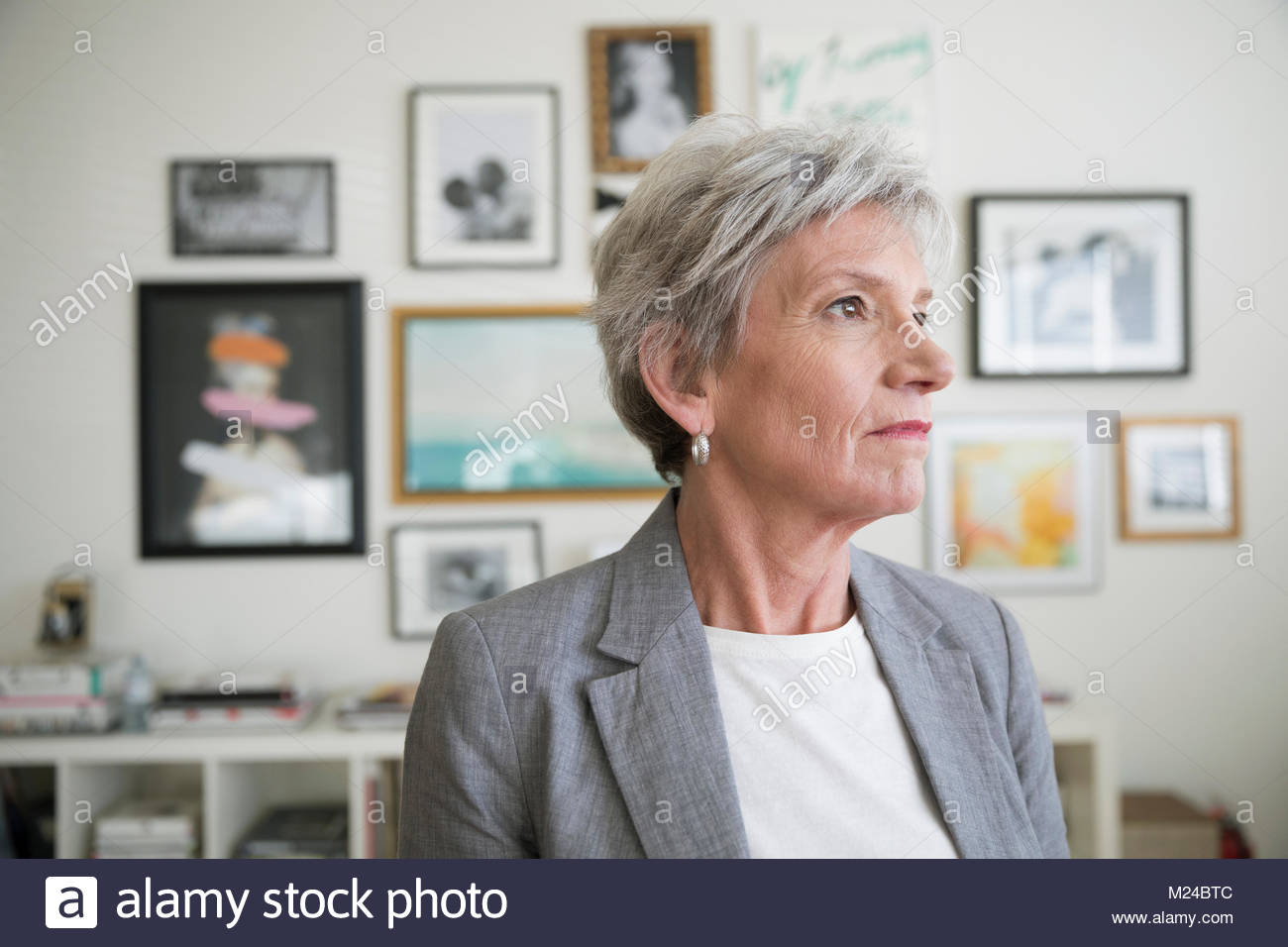 Thoughtful, forward looking businesswoman - Stock Image