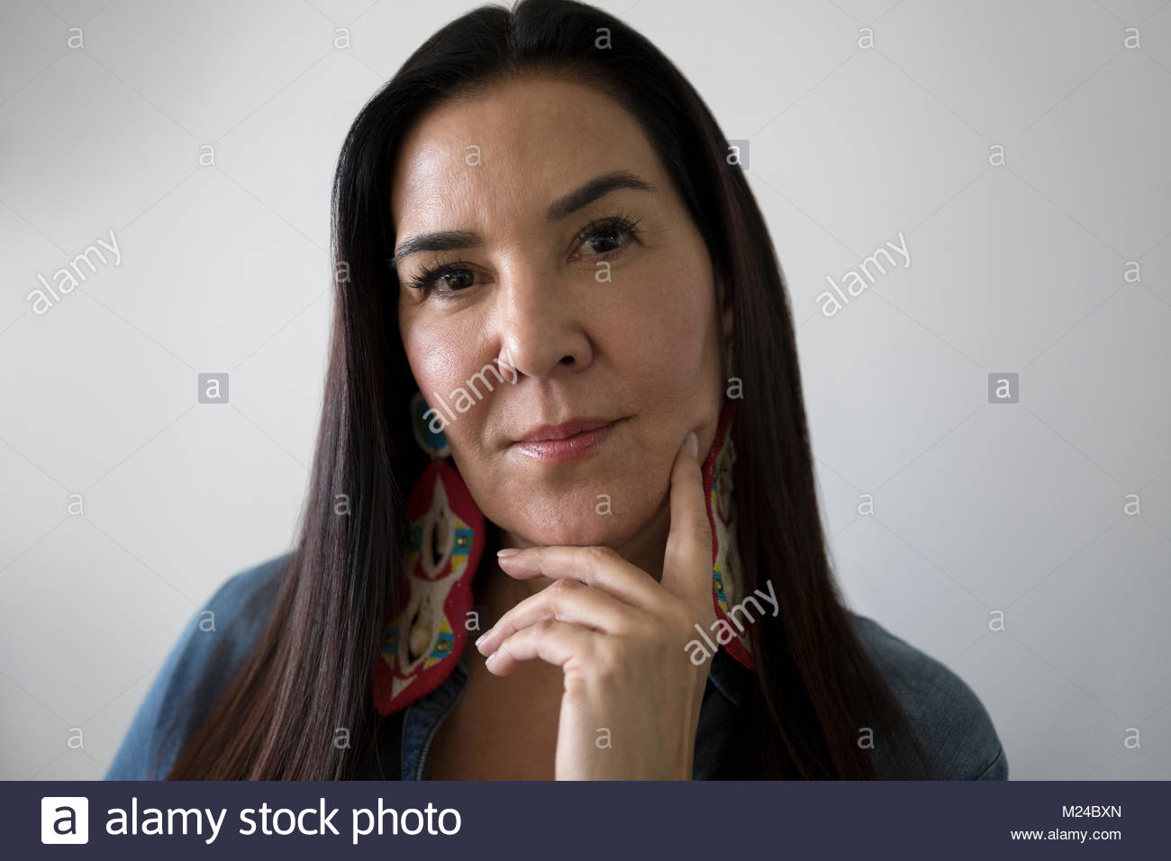 Portrait confident Native American woman - Stock Image