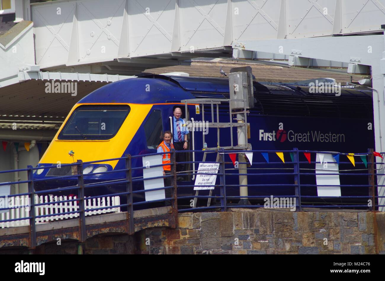 First Great Western Train at Dawlish Station with Bunting on the Day of the Air Show. Devon, UK. - Stock Image