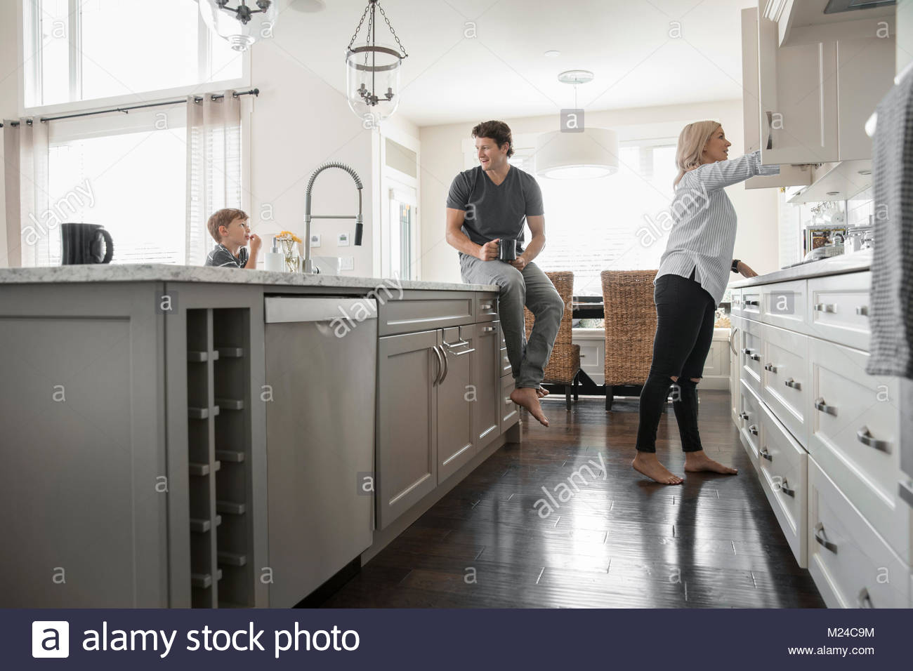 Family in kitchen - Stock Image