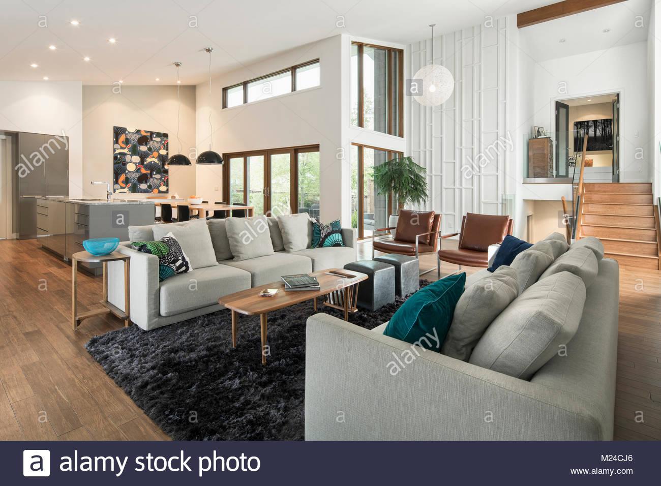 Home showcase mid-century modern open plan living room - Stock Image