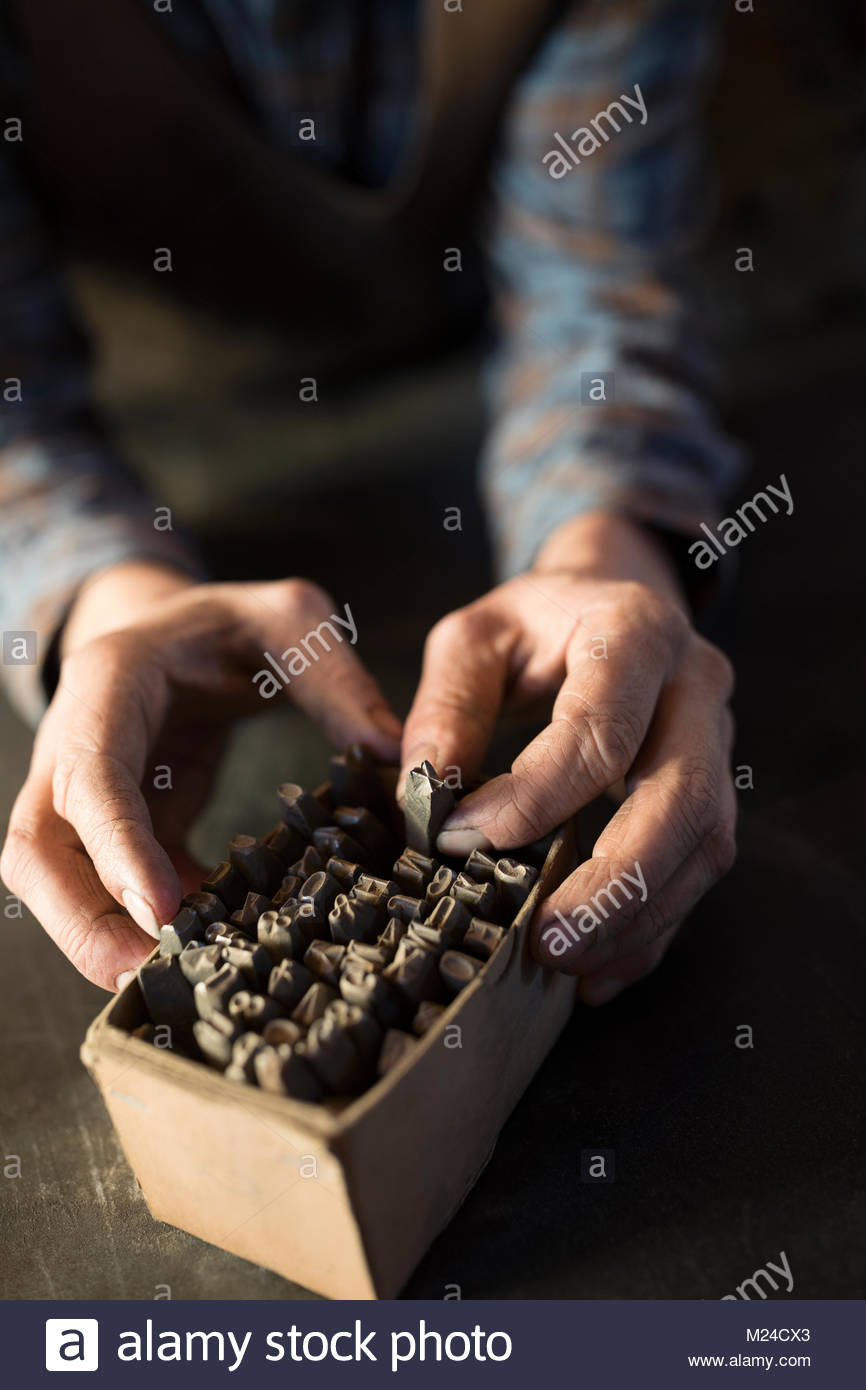 Close up blacksmith selecting tip from box Stock Photo