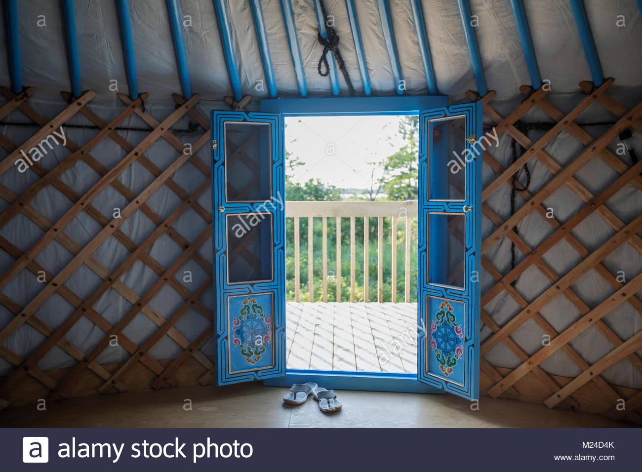 French doors open in yurt - Stock Image