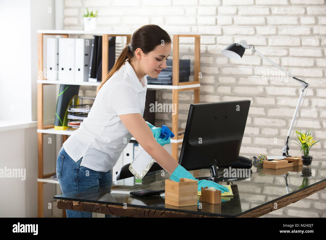 woman office furniture. Happy Young Woman Cleaning The Glass Office Desk With Rag Furniture