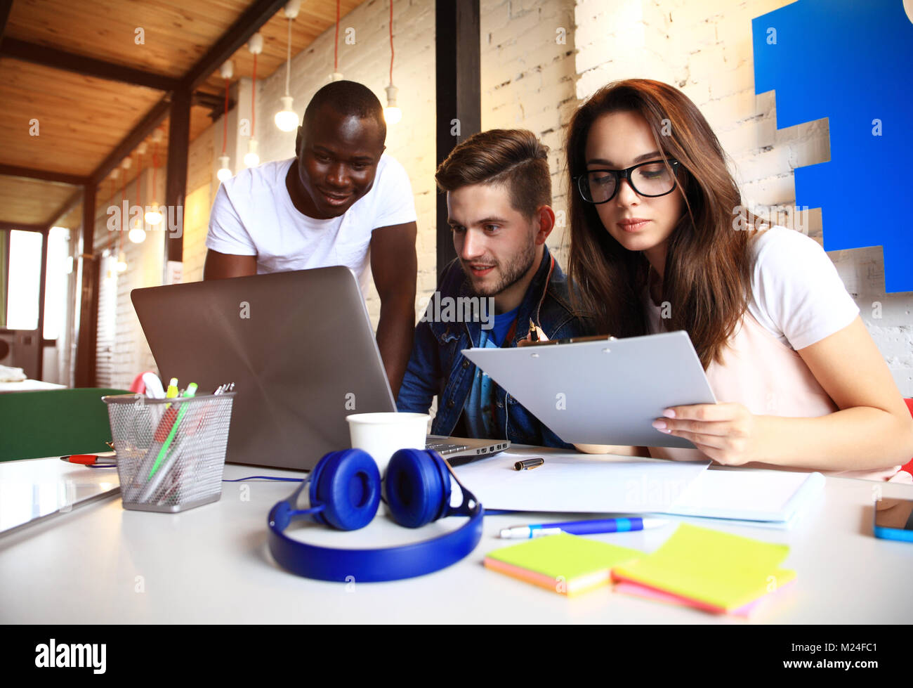 Startup Diversity Teamwork Brainstorming Meeting Concept.Business Team Coworkers Sharing World Economy Report Document - Stock Image