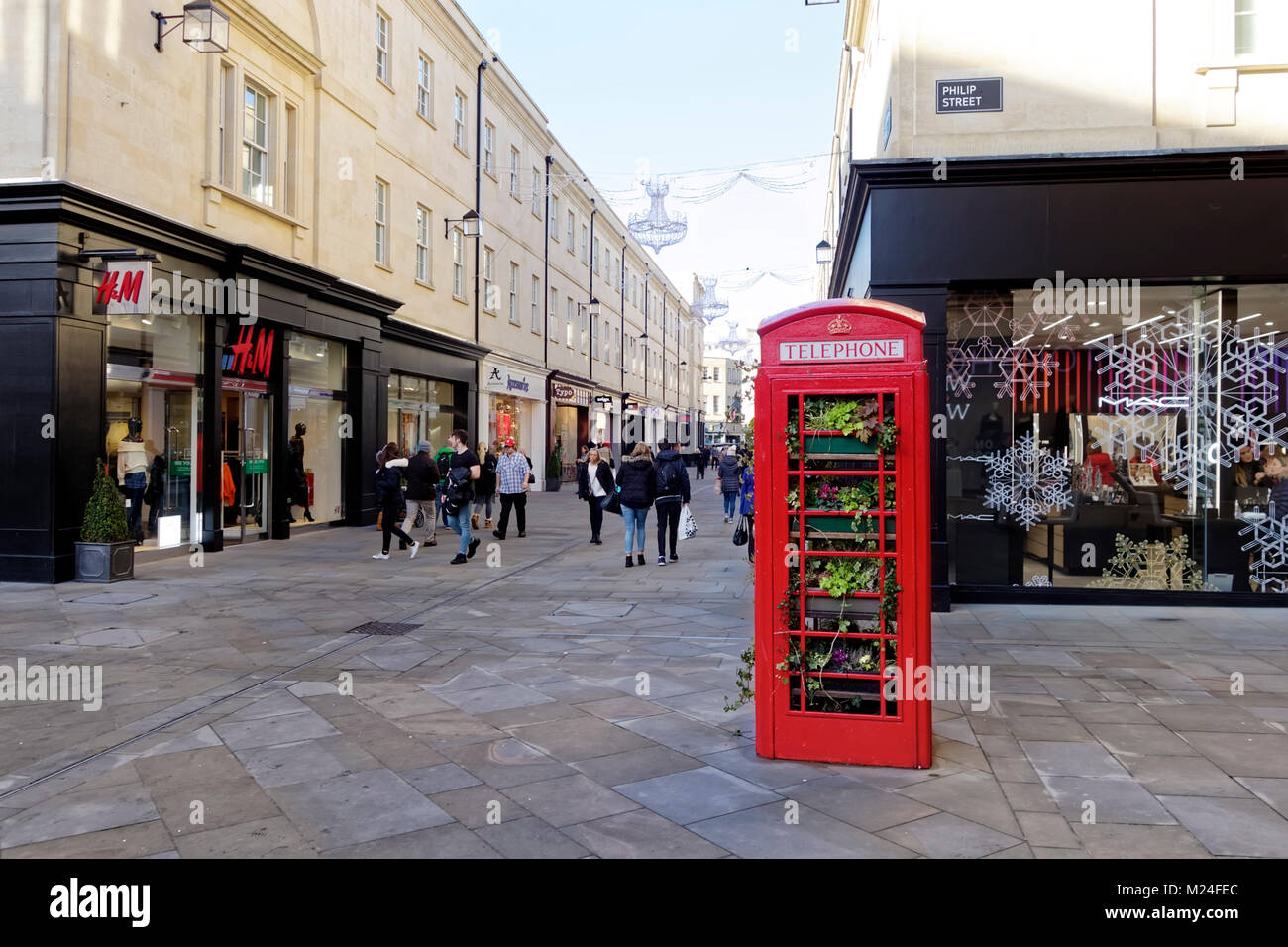 A Traditional British Red Telephone Box filled with plants in Philip Street, Bath, Somerset, England, United Kingdom - Stock Image