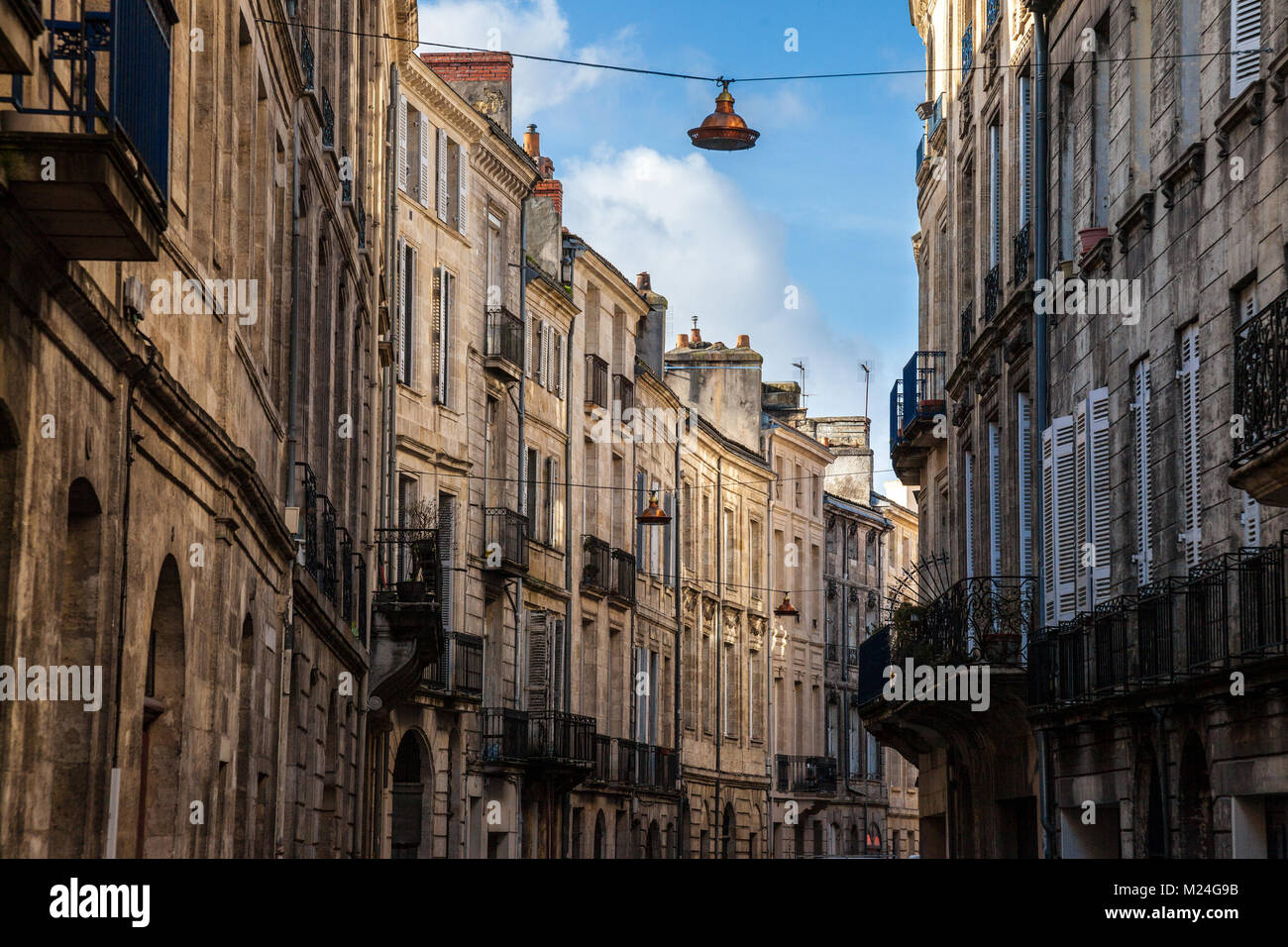 Facade of medieval buildings in a street in the city center of Bordeaux, France. These buildings are typical of - Stock Image