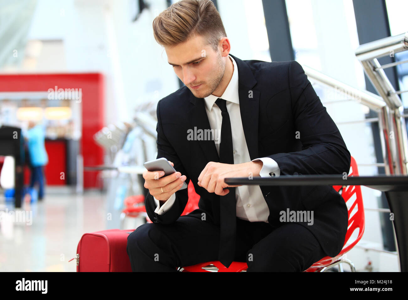 Young attractive business man using smartphone - Stock Image