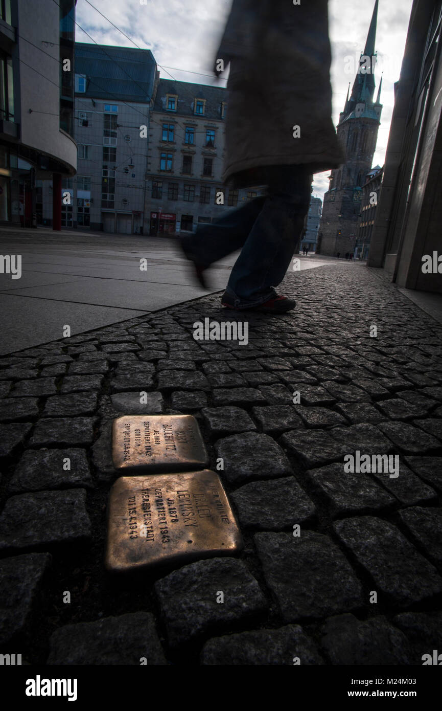 A Stolperstein marks the spot where individuals who were murdered by the Nazi regime last lived or worked on Große - Stock Image