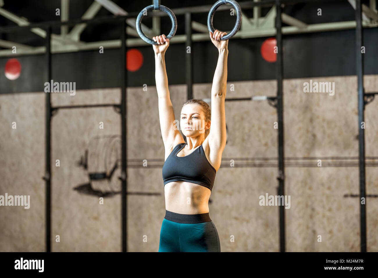 Woman training on the gymnastic rings - Stock Image