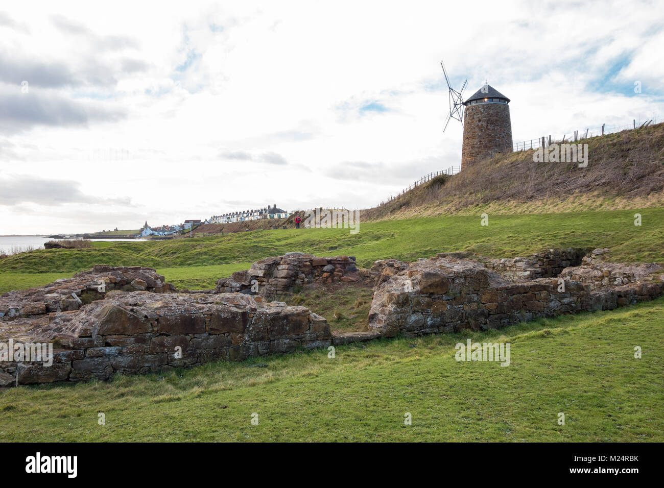 St Monan's Windmill and salt pans, with St Monan's in the distance, Fife, Scotland, UK Stock Photo