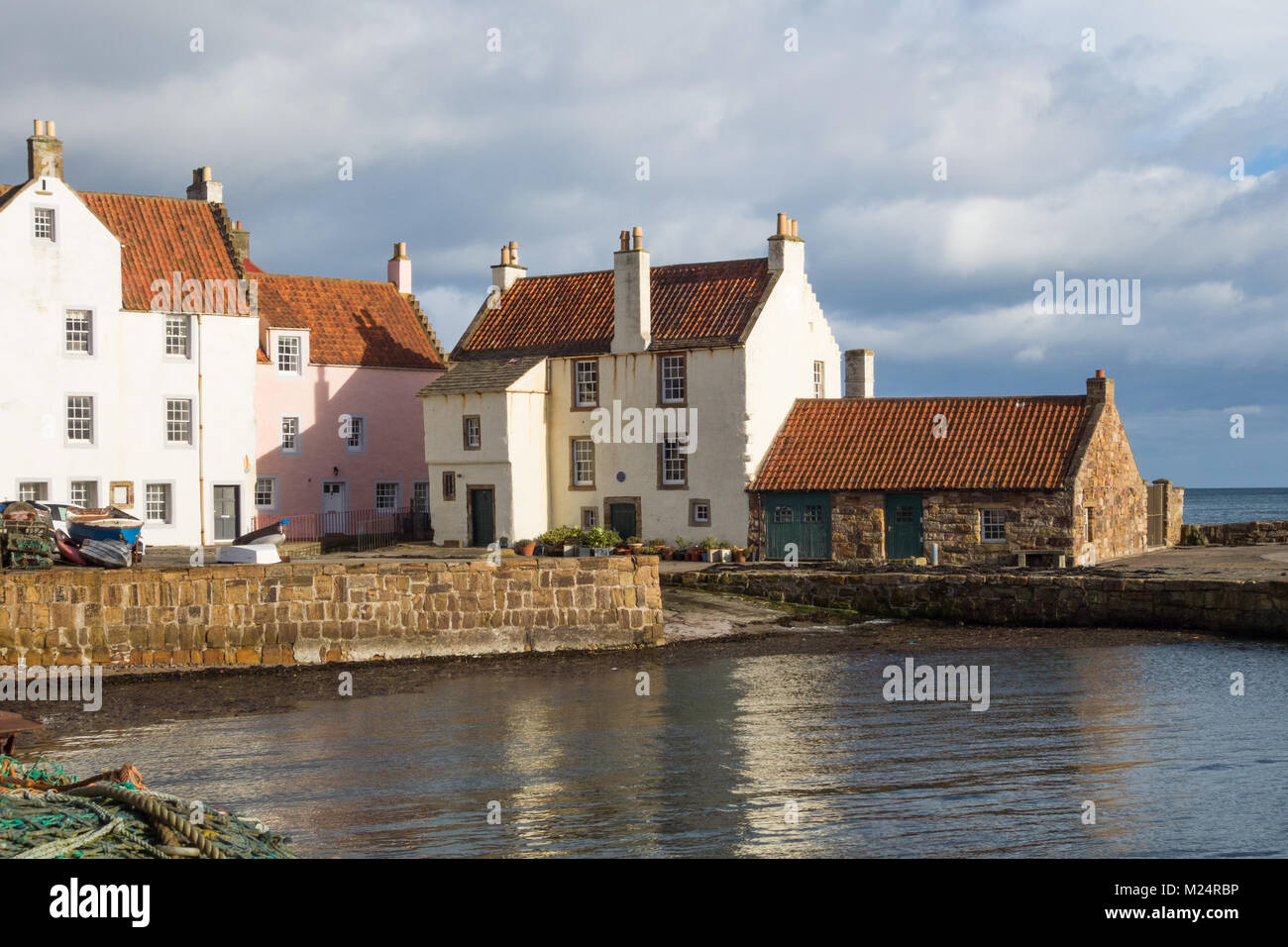 Crow stepped gable pantiled roofs on Gyles House and surrounding cottages in Pittenweem, Fife, Scotland, UK - Stock Image
