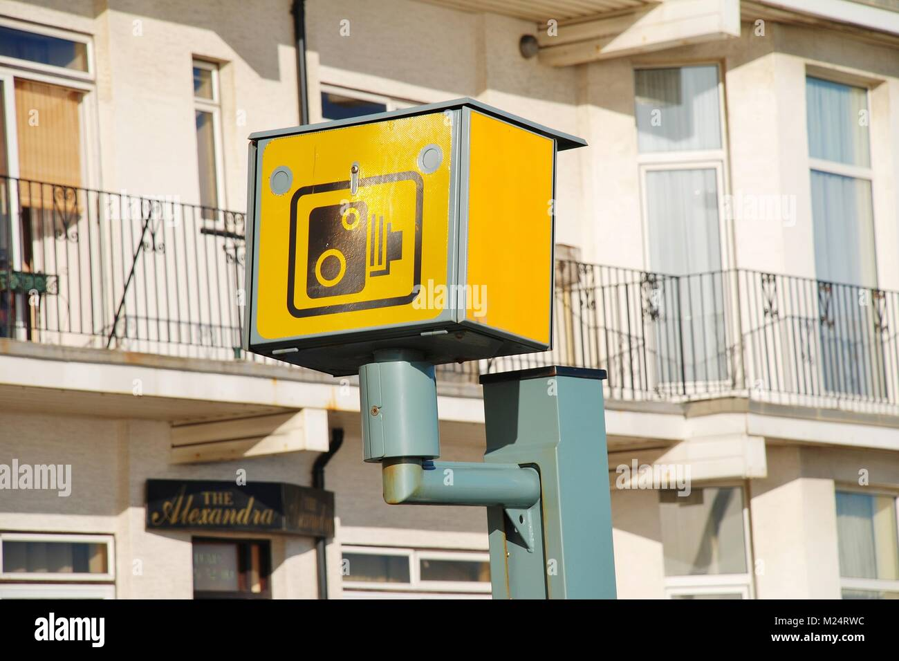 An iconic yellow  speed camera on the seafront road at Hastings in East Sussex, England on November 3, 2009. - Stock Image