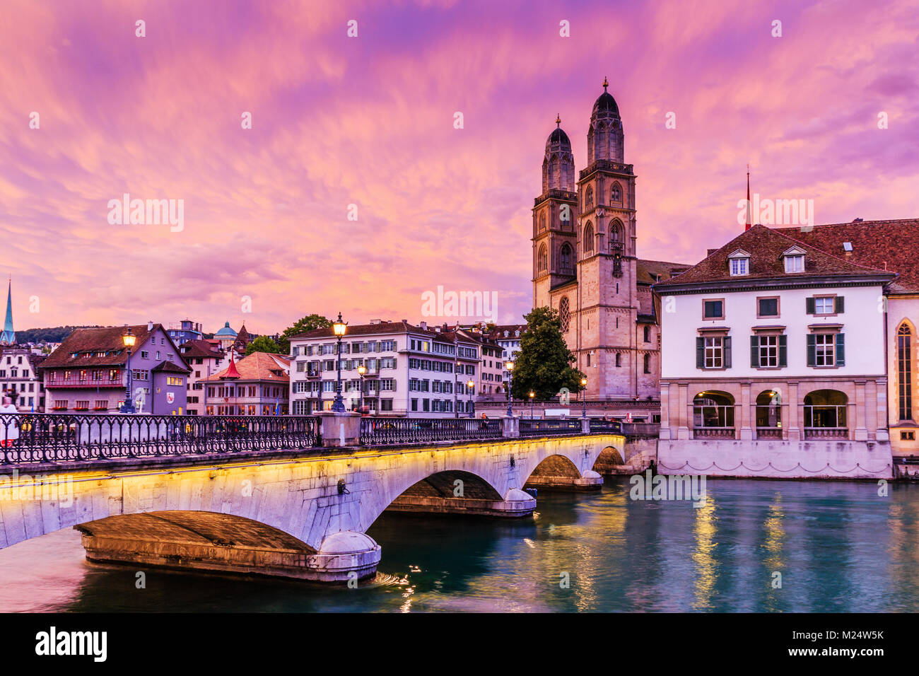 Zurich, Switzerland.  View of historic city center of Zurich with famous Fraumunster Church and Munsterbucke crossing - Stock Image