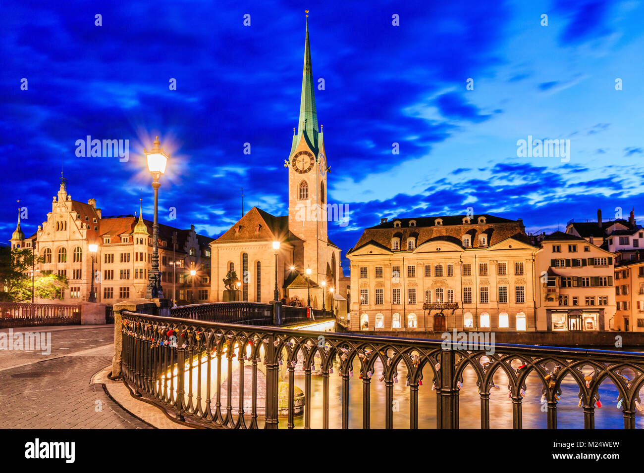 Lucerne, Switzerland. View of city center and Fraumunster Church at night. - Stock Image