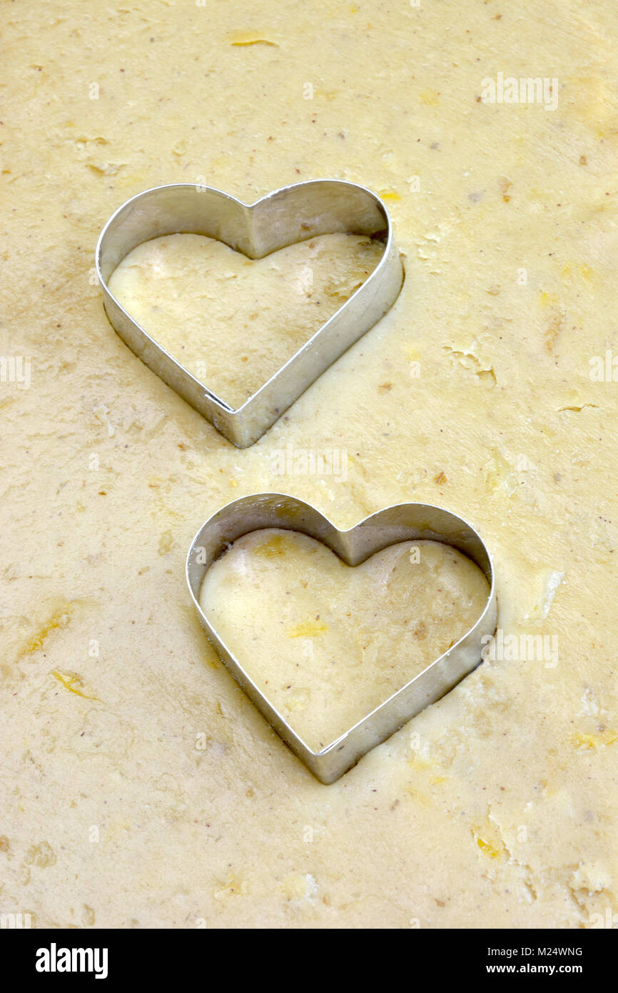 Making handmade heart shaped cookies - Stock Image