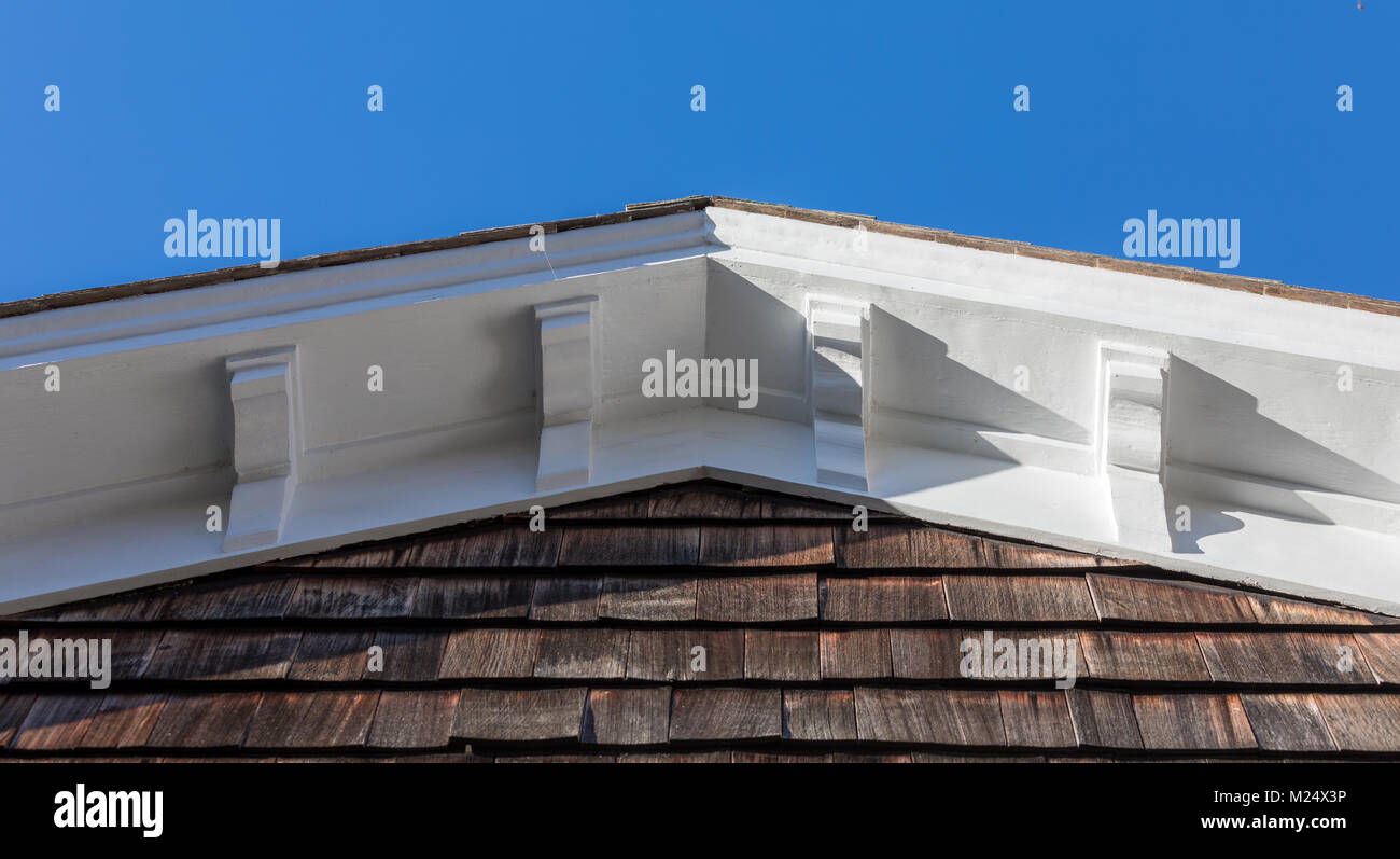 detail image of a decorative cornice on an old home - Stock Image