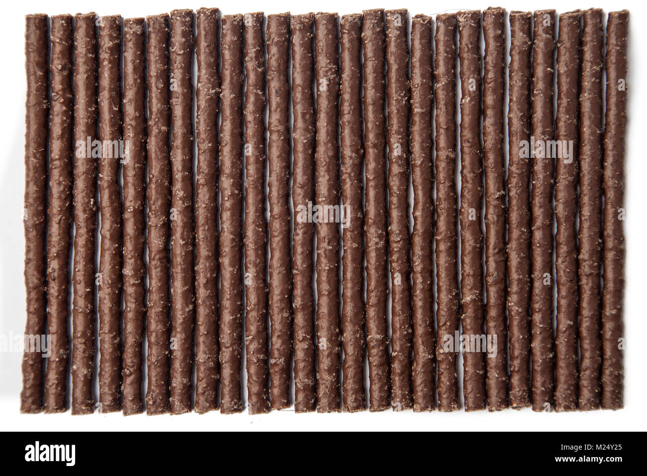 Chocolate Flavoured Stick Candy arranged side by side - Stock Image