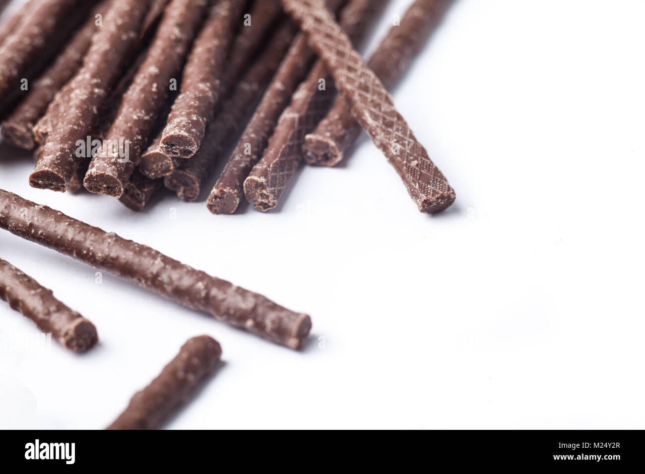 Chocolate Flavoured Stick Candy close up with copy space - Stock Image