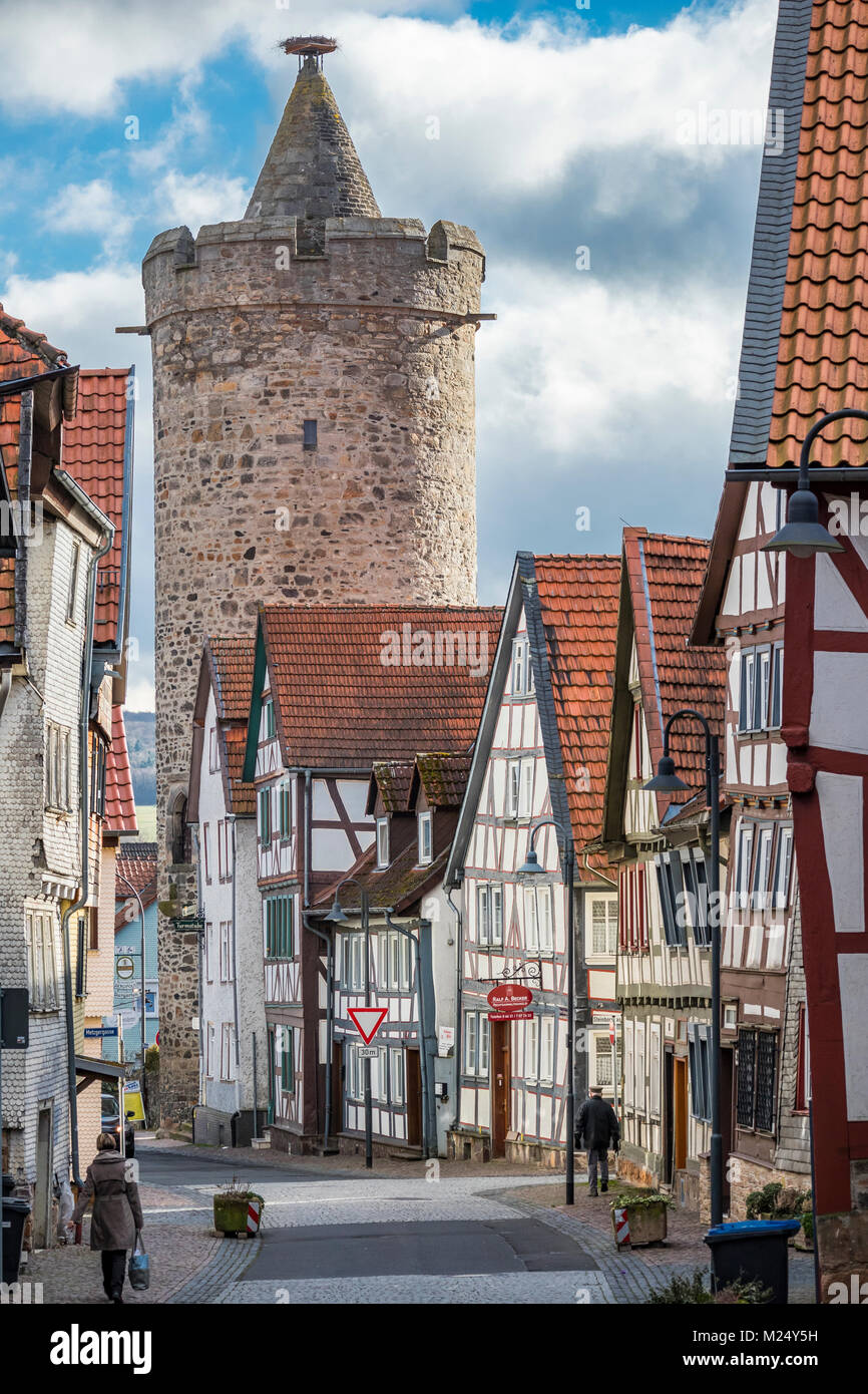 Alsfeld, Germany, half-timbered houses and Leonhards Tower in the old town area, street Untere Fulder Gasse - Stock Image
