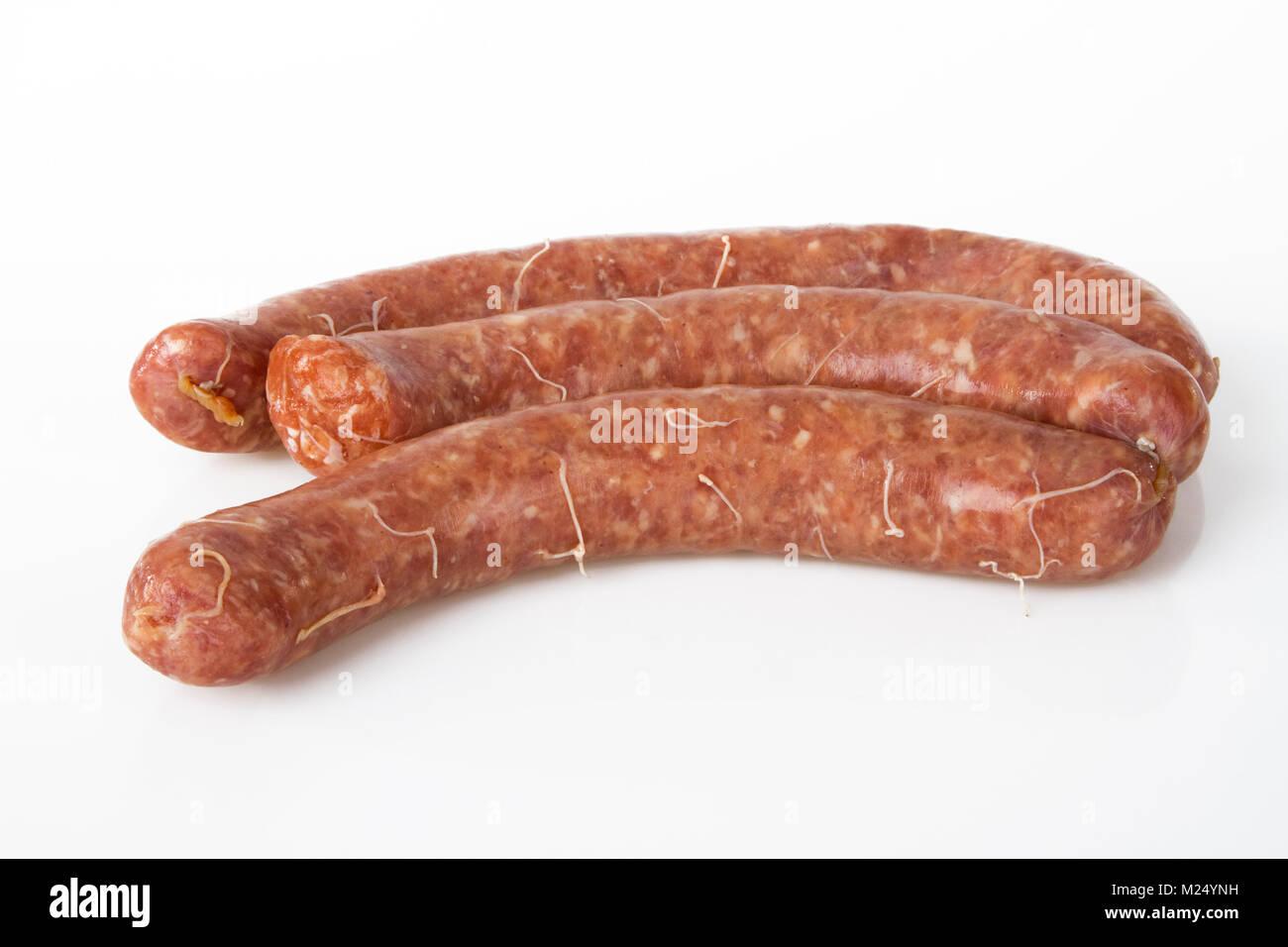 Fresh Raw Bratwurst on bright background Stock Photo
