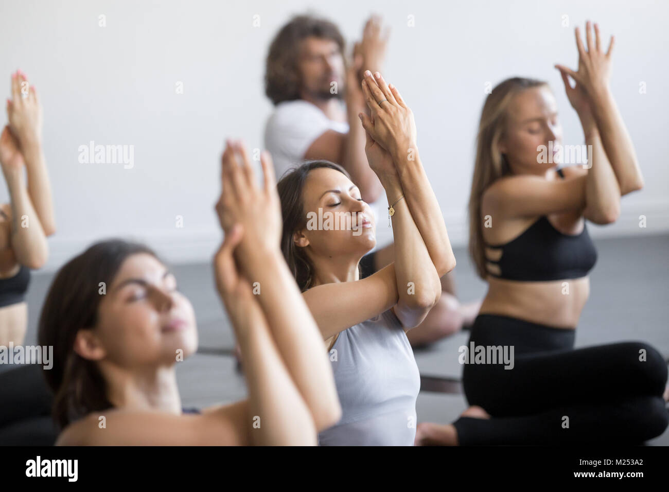 African confident investor sitting at workplace with hands behin - Stock Image
