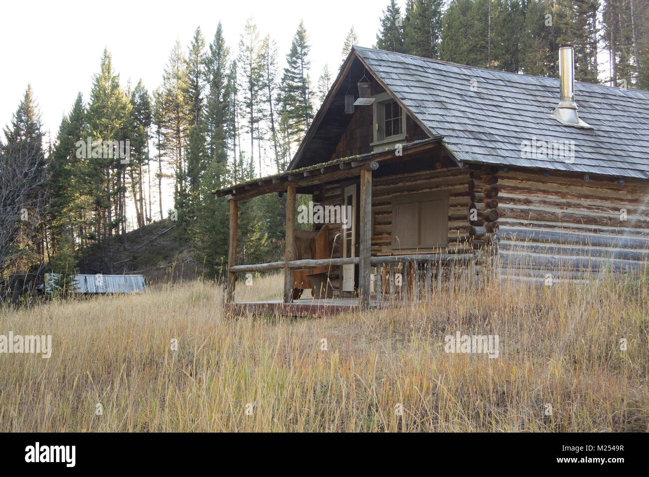 An old log cabin at the Garnet Ghost Town, on Bear Gulch, northwest of Drummond, Montana.  The mines in the area - Stock Image