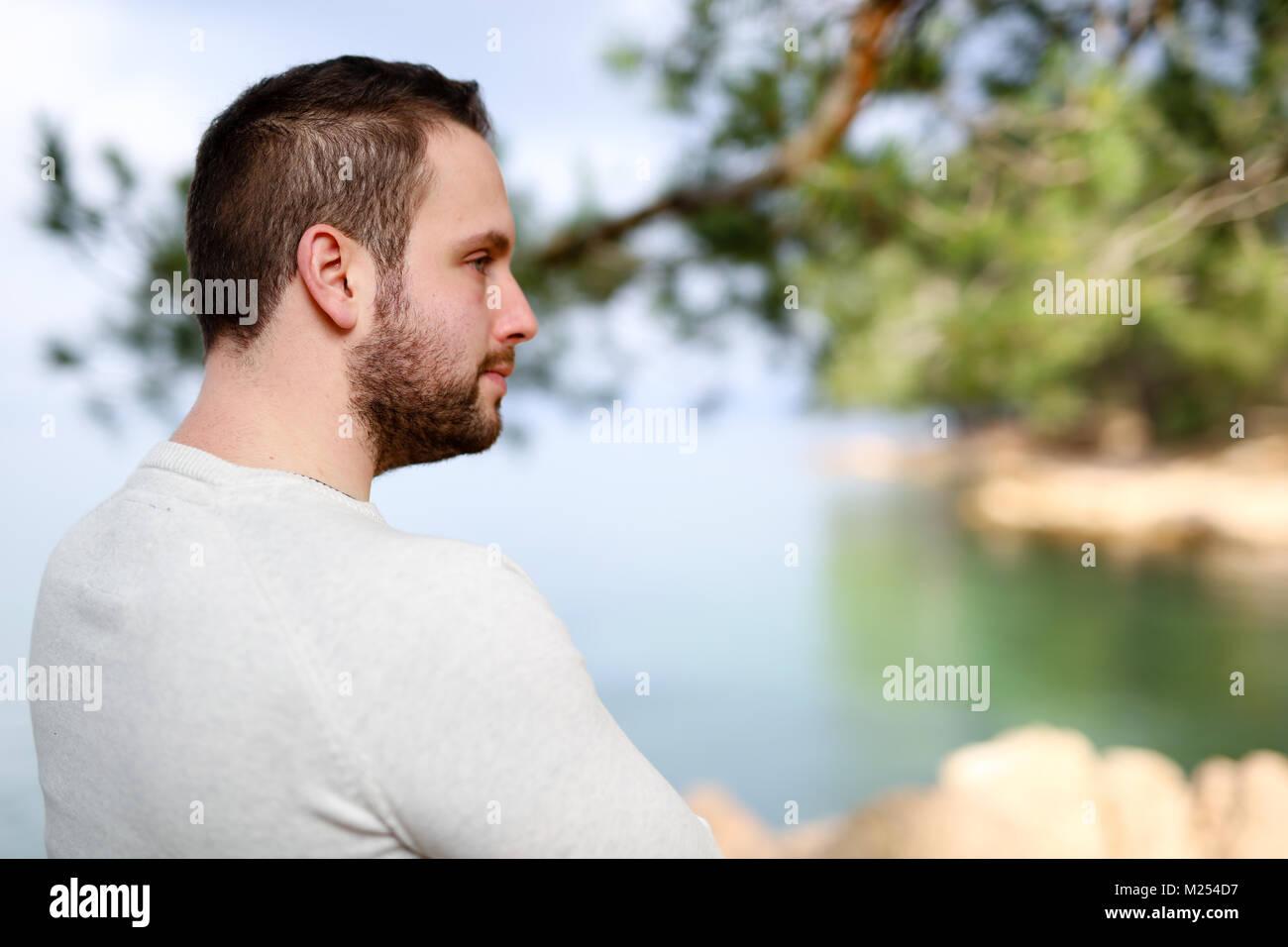 A male model enjoying the sea. - Stock Image