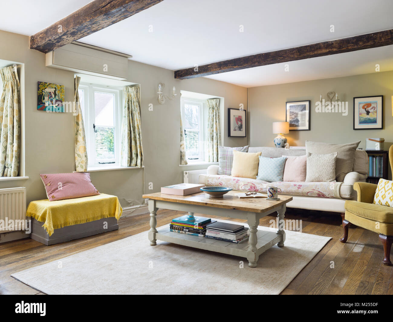 An interior view of a comfortable sitting room in a traditional English cottage home. - Stock Image