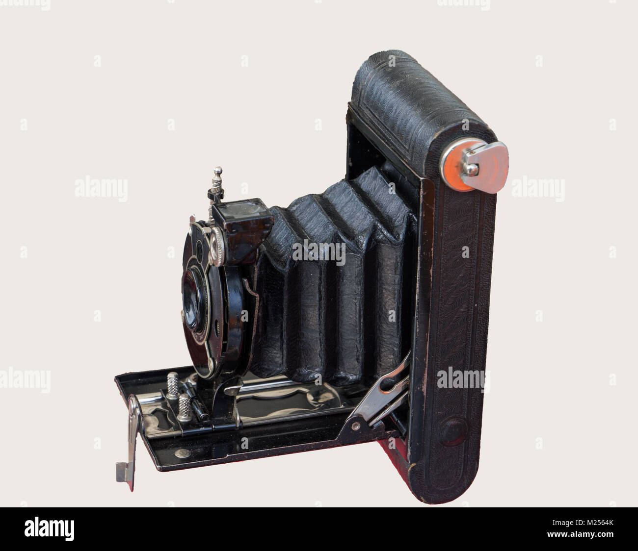 old bellows camera on a simple white background - Stock Image