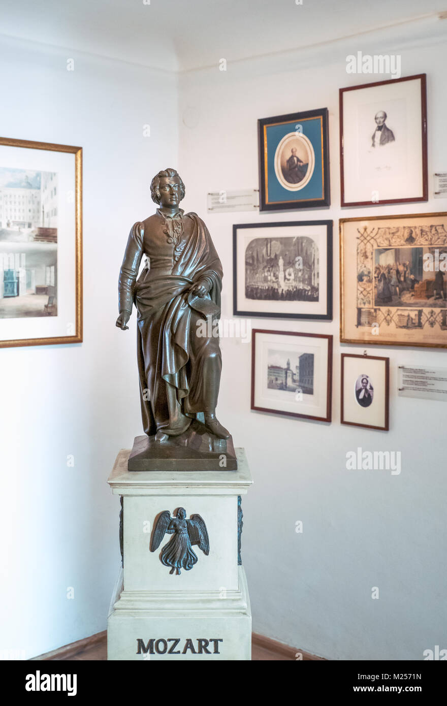 Austria, Salzburg, A statue of the musician and old memories in  the W. A. Mozart home - Stock Image