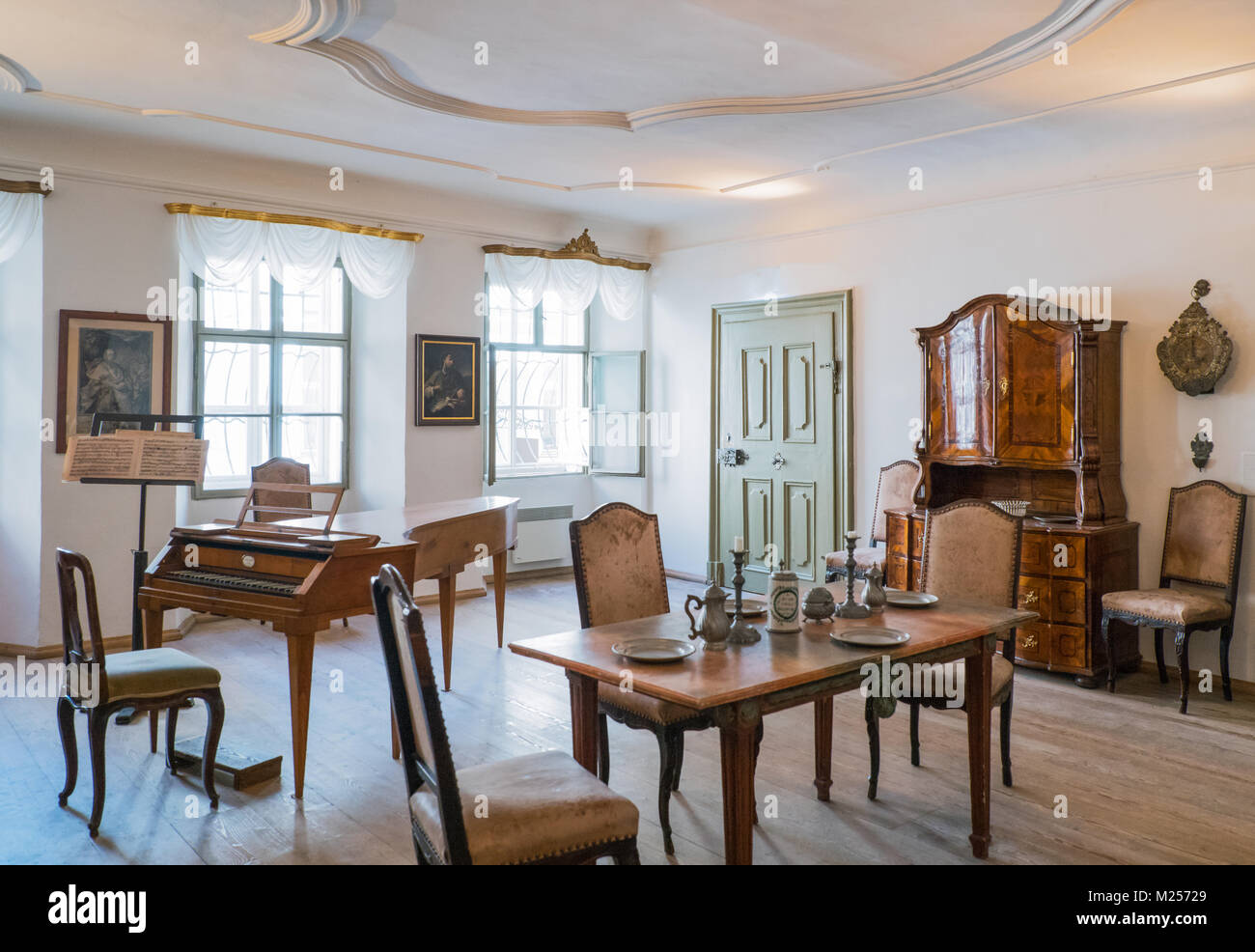 Austria, Salzburg, Antique furniture and an ancient harpsichord in the W. A. Mozart home - Stock Image