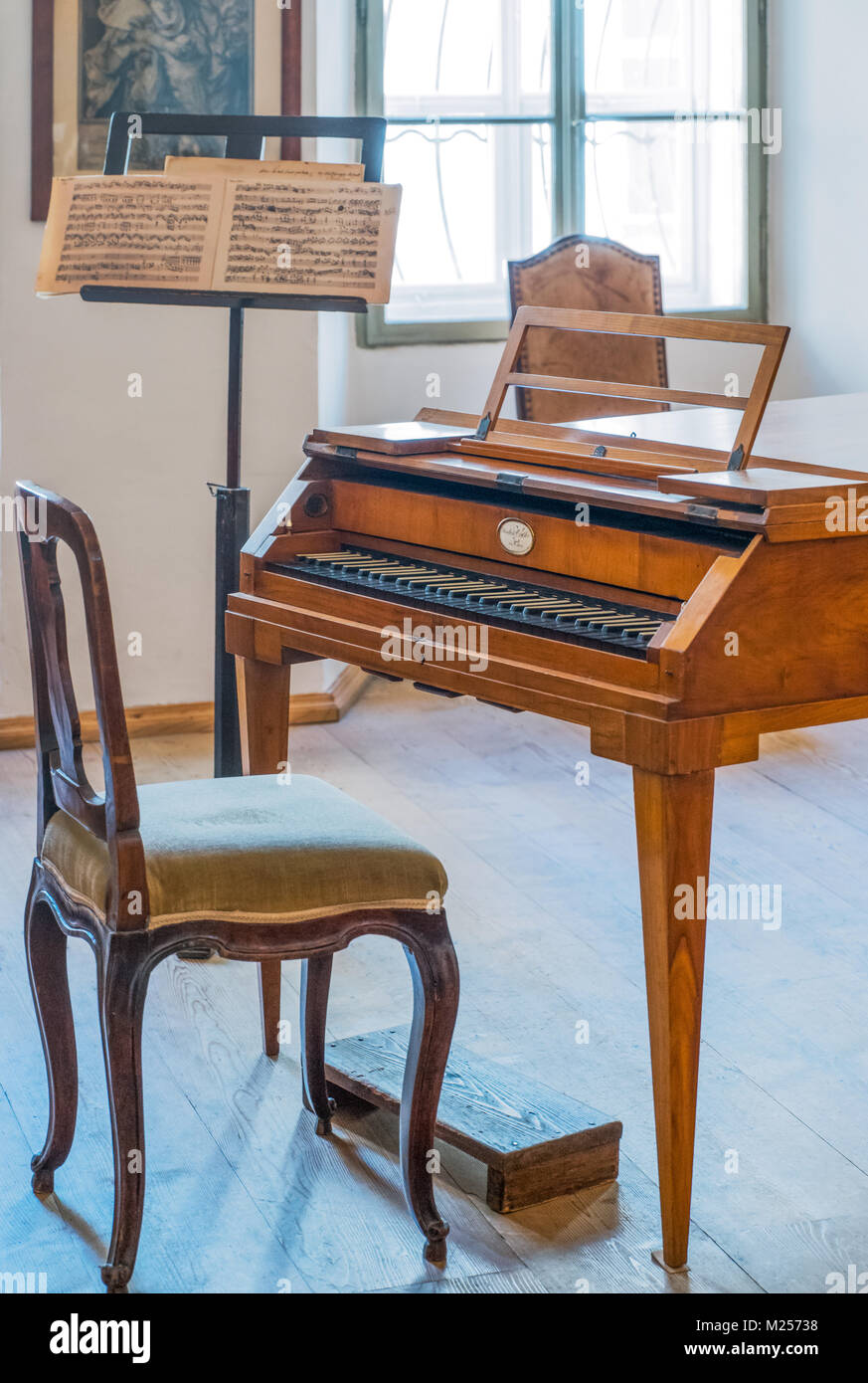Austria, Salzburg, An ancient harpsichord in the W. A. Mozart home - Stock Image