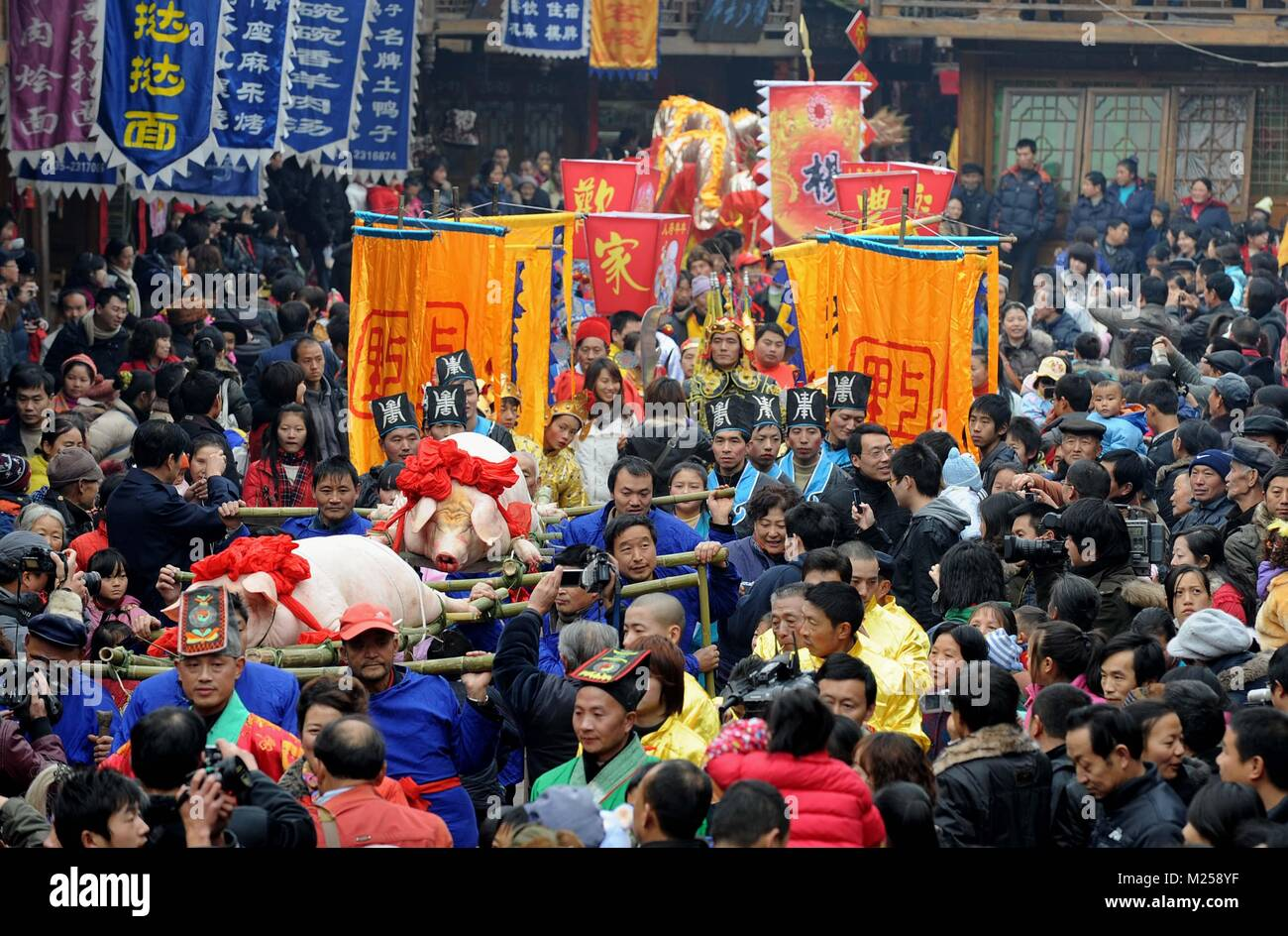 (180205) -- BEIJING, Feb. 5, 2018 (Xinhua) -- File photo taken on Dec. 19, 2009 shows people taking part in a traditional Stock Photo