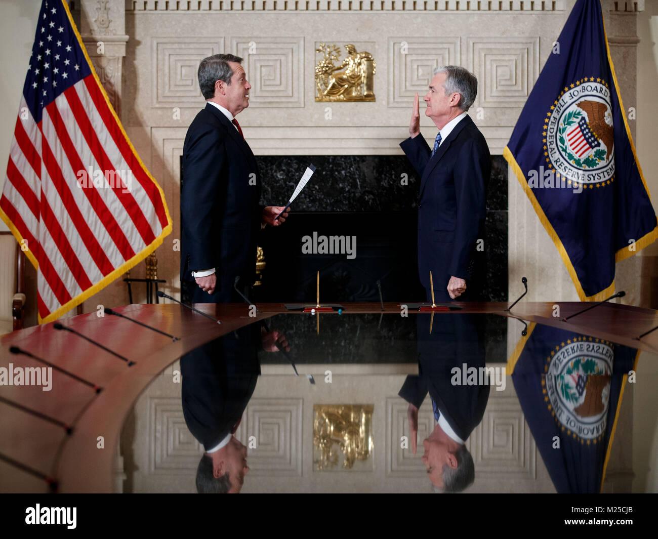 Washington, Washington, USA. 5th Feb, 2018. Jerome Powell (R) takes the oath of office as Chairman of the U.S. Federal - Stock Image