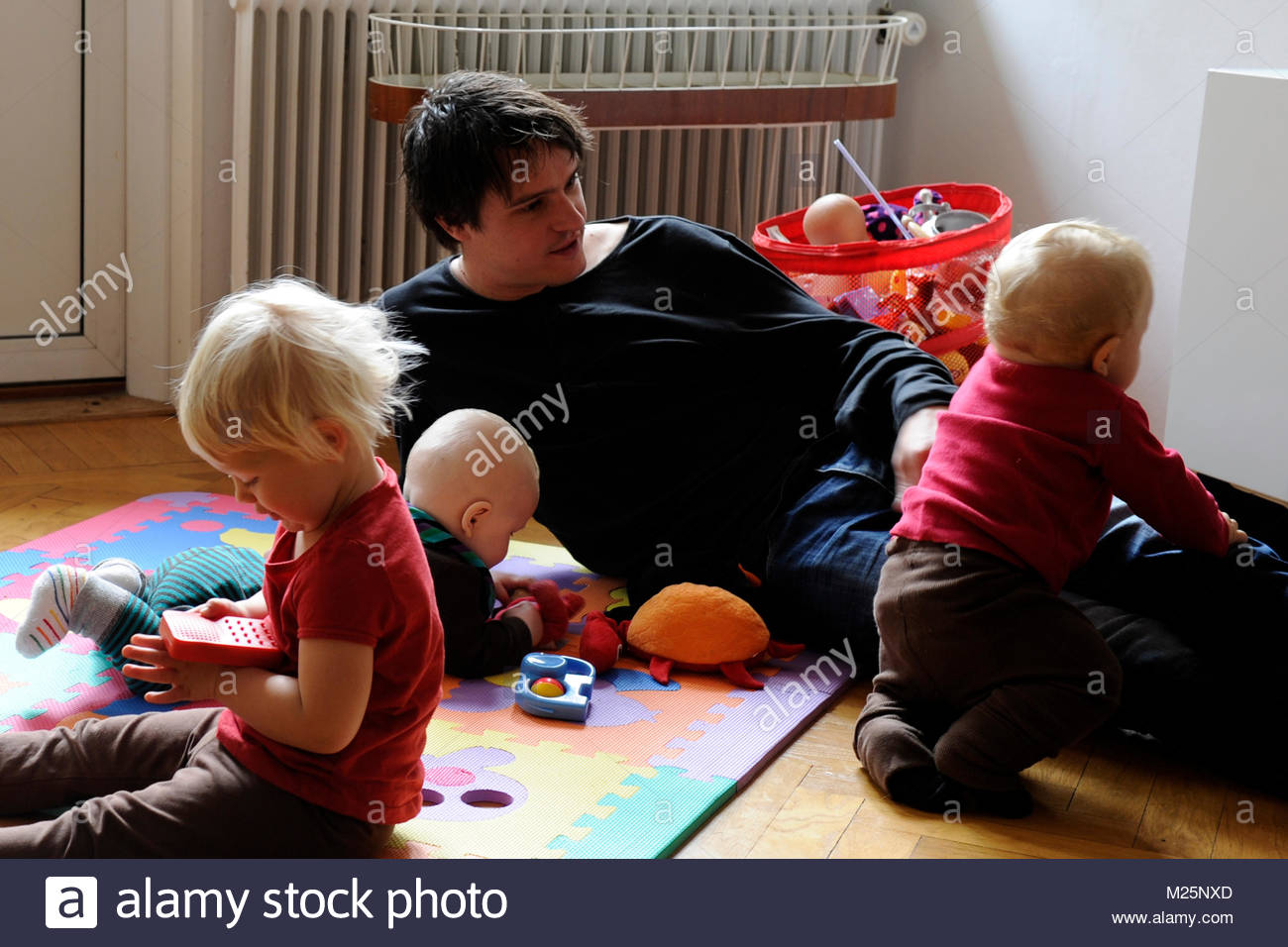 fathers on parental leave - Stock Image
