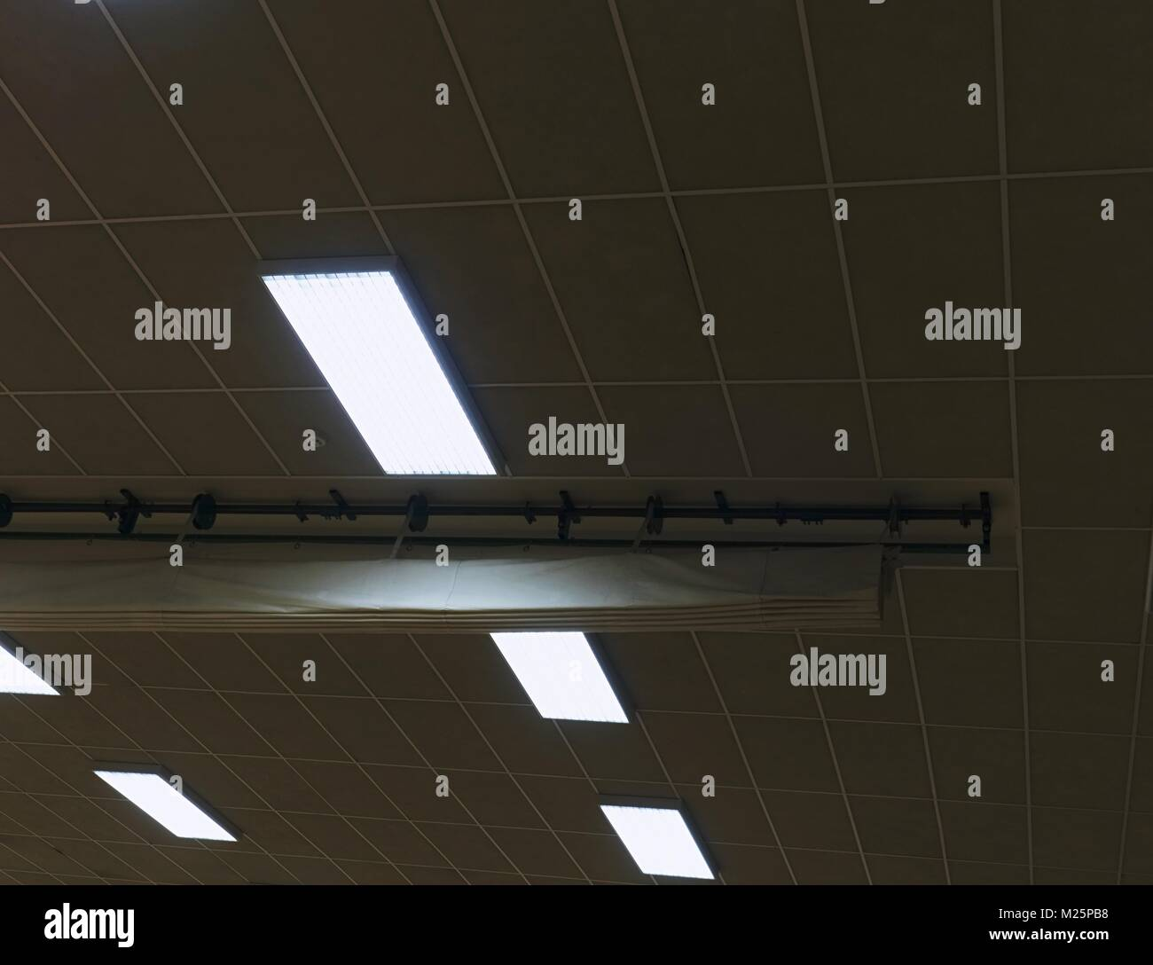 Industrial lighting panel of  mercury discharge tubes.Lighting system for comfortable light in workplaces  industrial - Stock Image