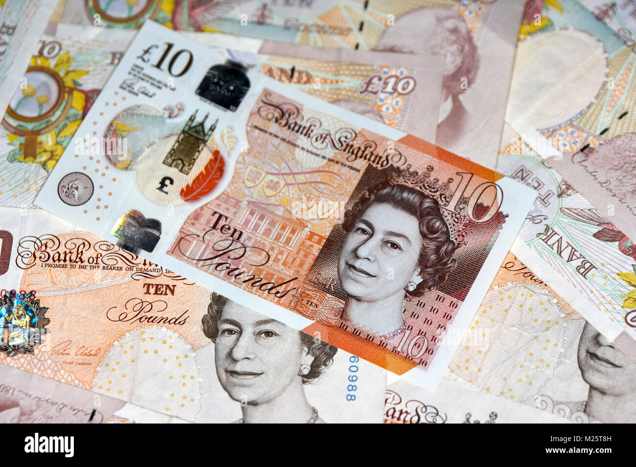 new polymer 10 quid notes with soon to be phased out paper 10 pound notes in the uk - Stock Image