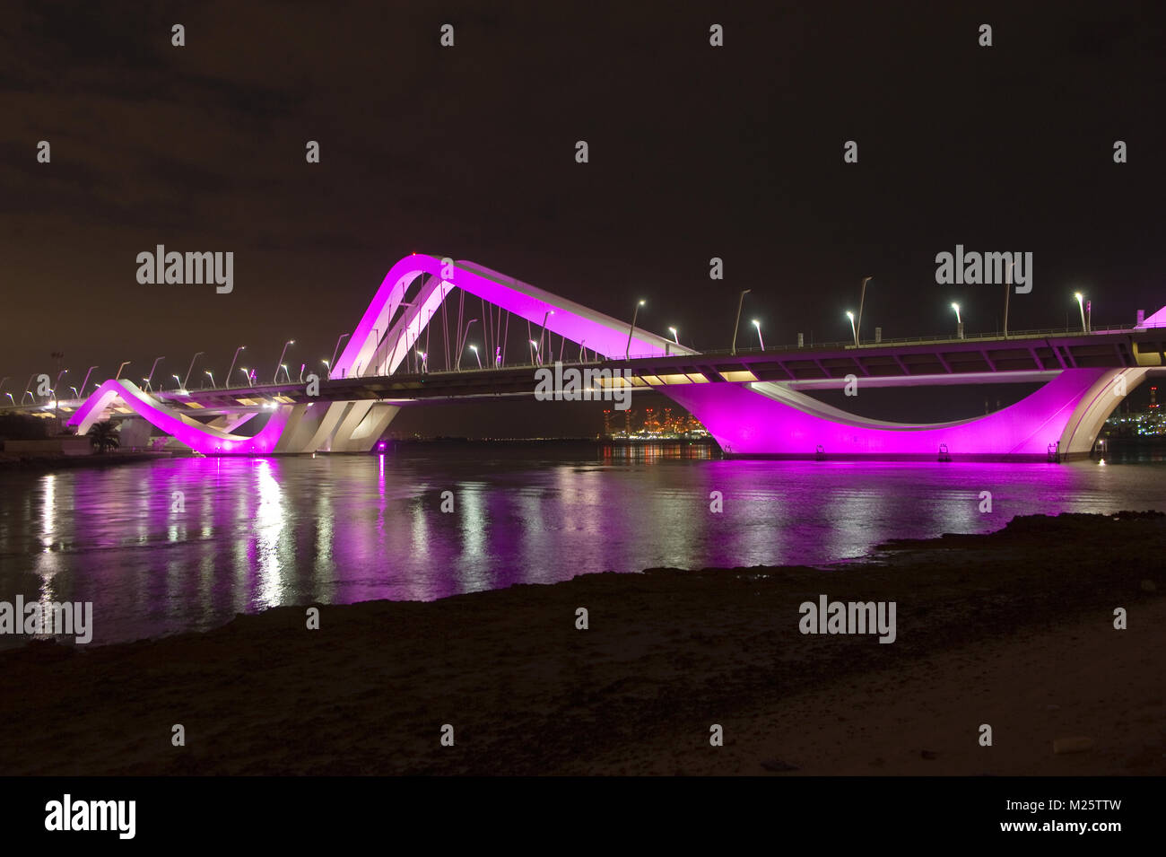 The Sheikh Zayed bridge in Abu Dhabi. Its curved design arches evoke undulating sand dunes of the desert. It also - Stock Image