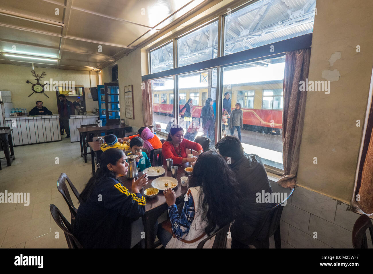 A family eating in the station cafe / canteen at Shimla station, India - Stock Image