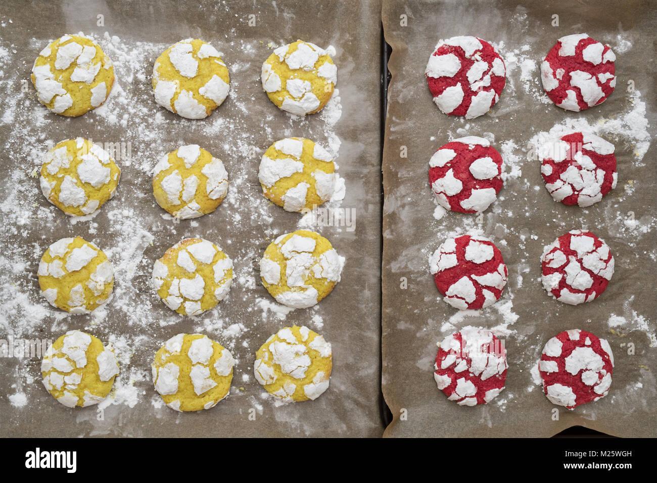 Homemade Lemon and Raspberry Crinkle Cookies on baking sheets. UK - Stock Image