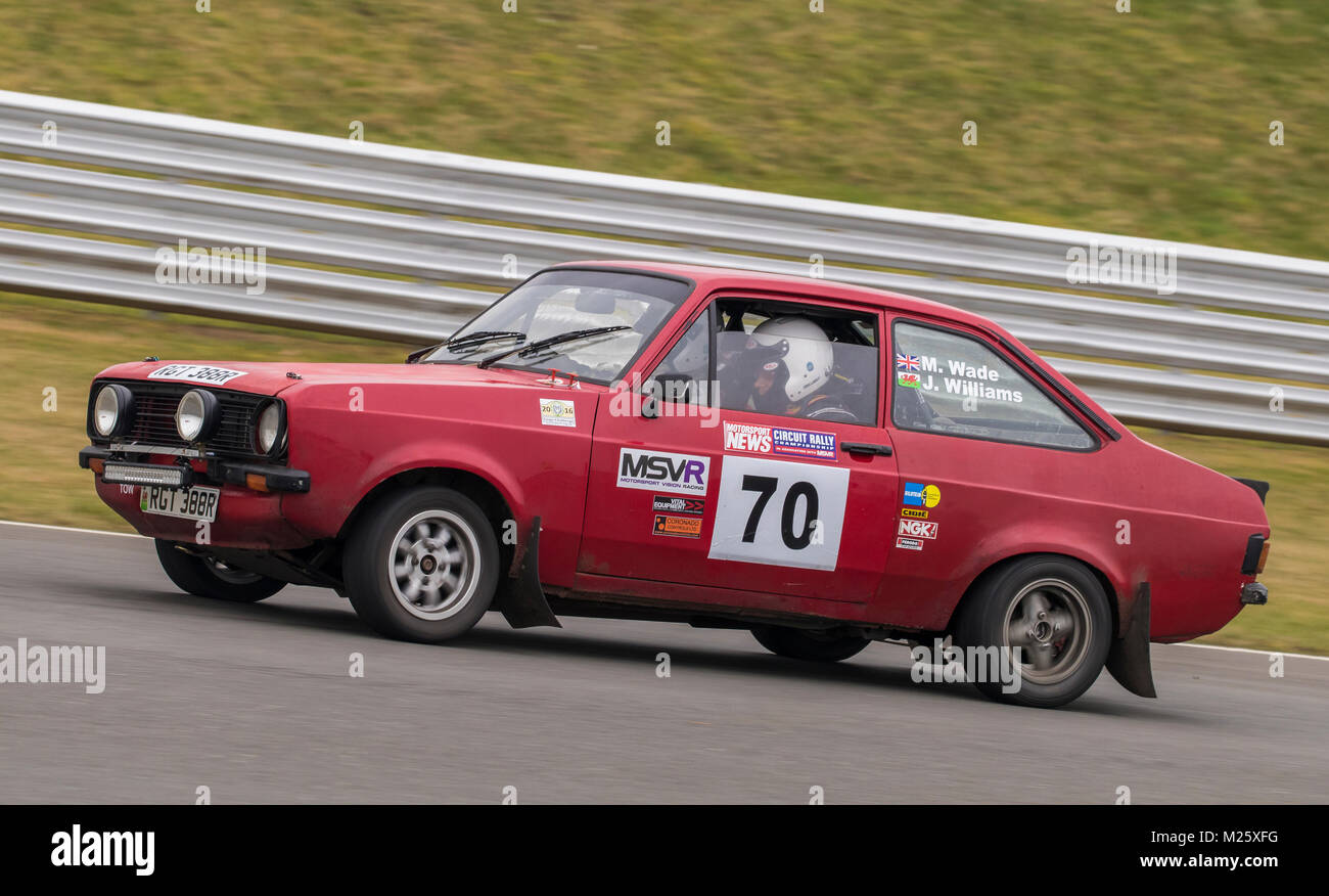 Ford Escort with driver Jonathan Williams and co-driver Mark Wade at the Motorsport News Circuit Rally Championship, - Stock Image