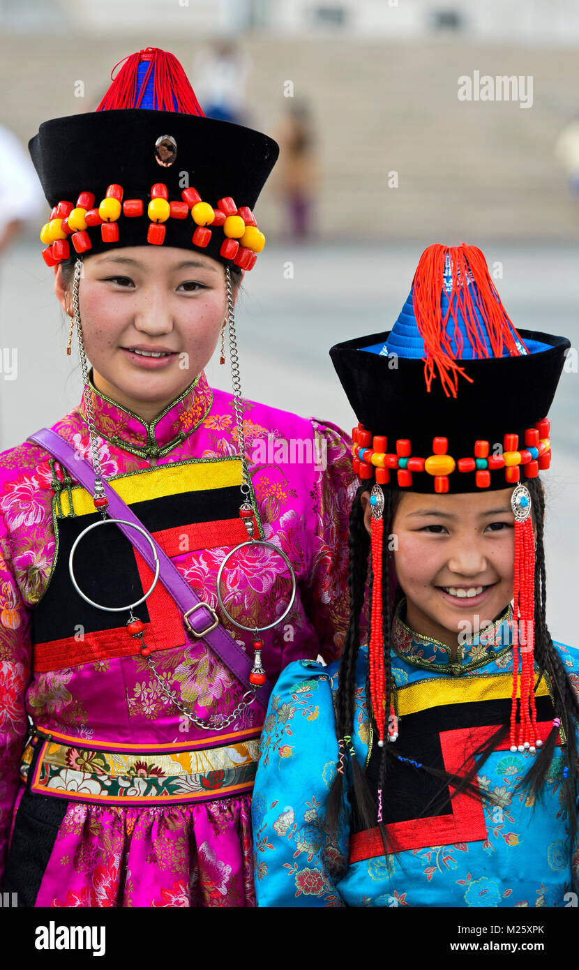 Two girls in traditional deel costume and the typical hat with the cone shaped top, Mongolian National Costume Festival, - Stock Image