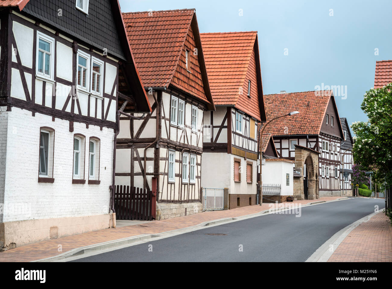 Half-timbered houses at Rimbachstrasse in Netra, Ringgau community, Hessen, Germany - Stock Image
